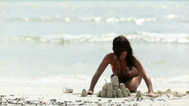 Beach Woman Sand Castle video