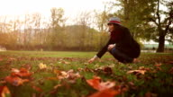 A beagle leaps as his master teases him with an autumn leaf video