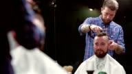 beard barber making haircut to hipster client video