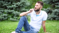 Bearded hipster smoking electronic cigarette. video