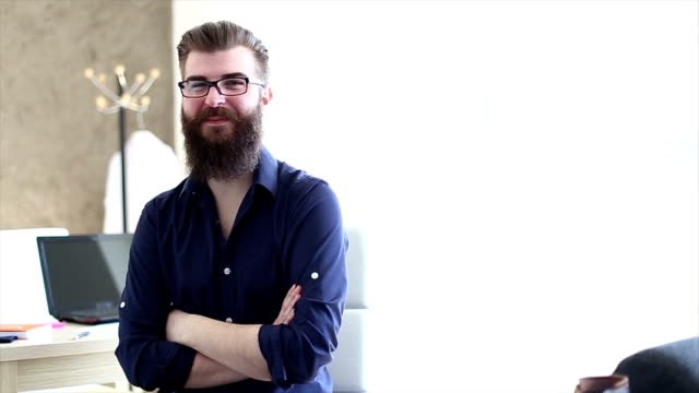 Bearded hipster student being interviewed for a job video