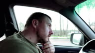 Bearded man driver waits for the green light video