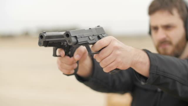 Bearded Man Firing Two Semi Automatic Handguns video