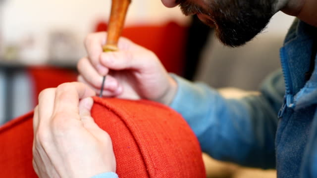 bearded man himself repairs the red chair video