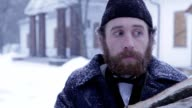 bearded man in clothes of 19 centuries with wood in his hands, Russian winter video