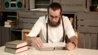 Bearded man reading book video