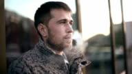 Bearded man smoking electronic cigarette. video