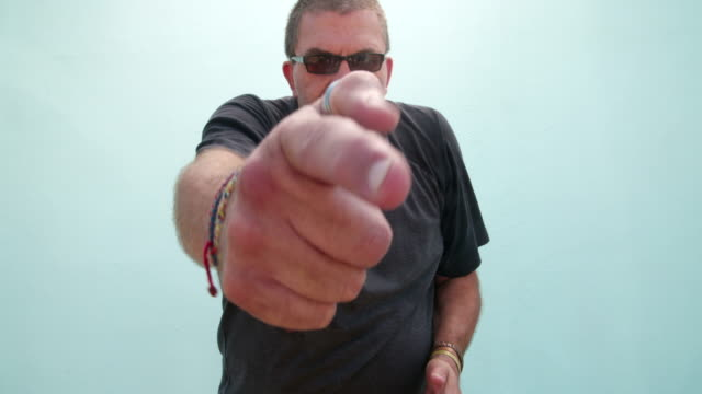 Bearded mature man pointing and looking at camera video