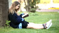 Beatiful Girl Reading Book In The Park video