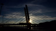 Beaurtiful cable-stayed bridge at sunset, tram car pass by video
