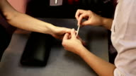 Beautician hand filing nails video
