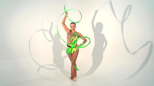 Beautiful acrobat dancing with a sash video