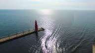 Beautiful Aerial Lake Fly-Over Lighthouse, Harbor With Boat video