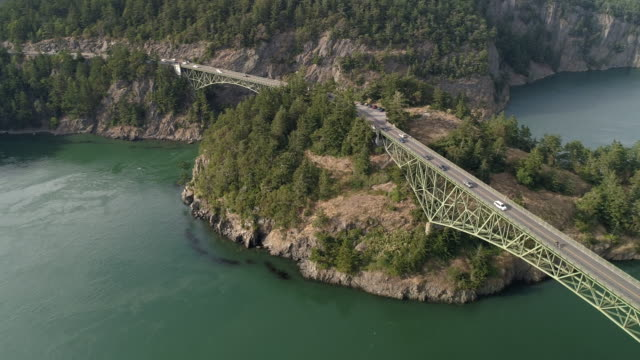 Beautiful Aerial of Cars on Road Trip Crossing Large Bridge Between Pacific Northwest Ocean Islands video