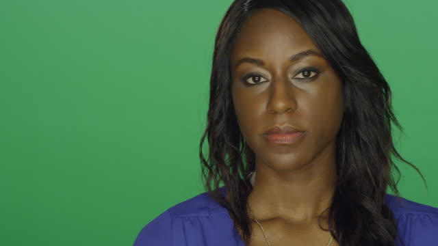 Beautiful African American woman looking concerned, on a green screen studio background video
