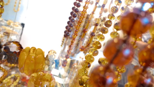 Beautiful amber beads and other jewelry in the shop video
