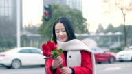 beautiful asian girl holding bunch of red flower video