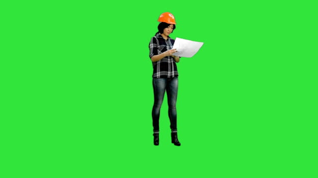 Beautiful asian girl laughing throwing pieces of paper on a Green Screen, Chroma Key video