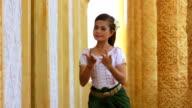 Beautiful Asian Girl performs Cambodian folk dance in temple video