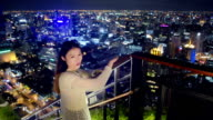 Beautiful asian girl smiling at the top of a building video