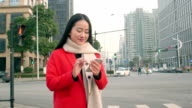 beautiful asian girl using smart phone in modern city video
