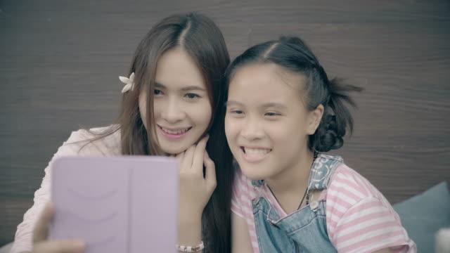 Beautiful asian girl using tablet video