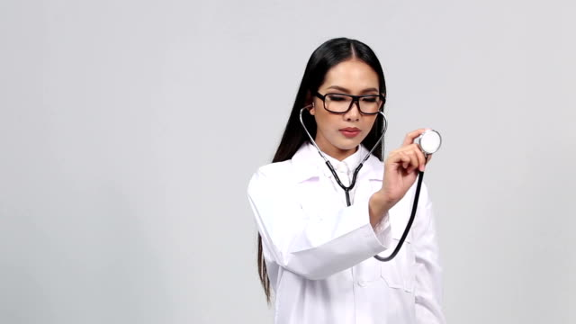 Beautiful Asian Tan Skin Woman Doctor White Shirt suit with stethoscope on neck and checking listening heart pulse pose video