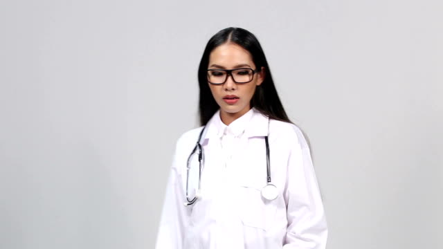 Beautiful Asian Tan Skin Woman Doctor White Shirt suit with stethoscope on neck walk and get Heart Attach fall down video