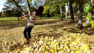 Beautiful Asian woman falls into leaves video