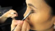 Beautiful Asian Woman Has Eye Shadow Brushed On video