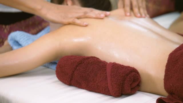 Beautiful Asian woman having relaxing in spa massage video