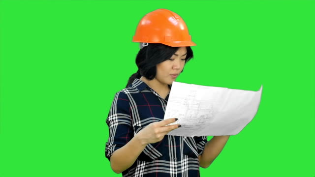 Beautiful asian woman laughing throwing papers on a Green Screen, Chroma Key video