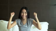 4K: Beautiful Asian woman looking and smiling at the camera with her thumbs up video