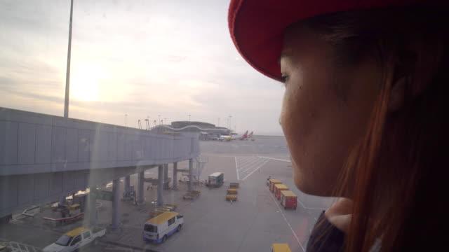 Beautiful Asian Woman Looking The Plane In The Hongkong Airport video