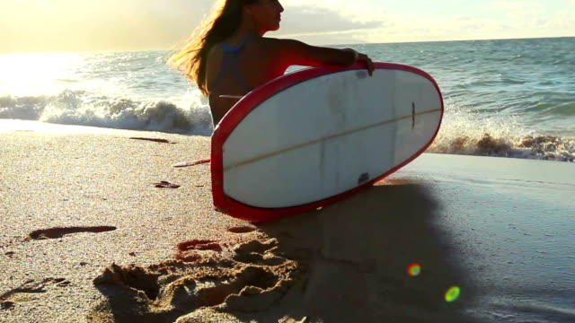 Beautiful Attractive Young Girl at the Beach with Surfboard video