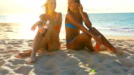 Beautiful Attractive Young Women in Bikinis Sitting on the Beach video