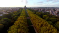 Beautiful autumn park alley aerial shot, Brussels Park Elisabeth. Beautiful aerial shot above Europe, culture and landscapes, camera pan dolly in the air. Drone flying above European land. Traveling sightseeing, tourist views of Belgium. video