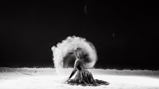 Beautiful ballerina dancing in powder snow video
