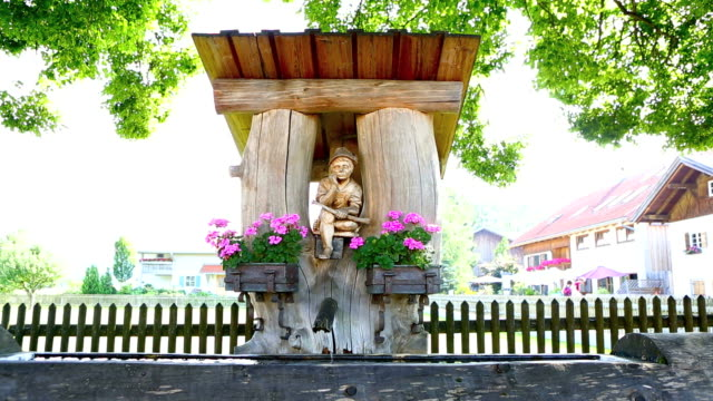 Beautiful Bavarian fountain with flowers in summer video