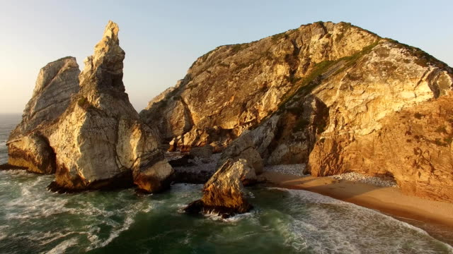Beautiful beach Praia da Ursa at sunset aerial view video