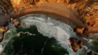Beautiful beach Praia da Ursa at sunset aerial view video
