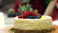 Beautiful berry cheese cake on festival decorated table video