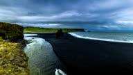 A beautiful black sand beach Reynisdrangar - basalt columns, towering 70 meters above the waters of the North Atlantic. Reynisdrangar beach, Iceland video