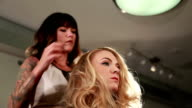 Beautiful blond getting her hair styled video