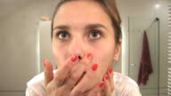 beautiful blonde girl cleansing her face video