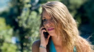 beautiful blonde girl having conversation at the mobile phone: smartphone, call video