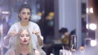 Beautiful blonde in a barber shop video
