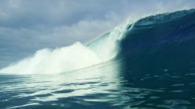 Beautiful blue ocean wave breaking over the camera video