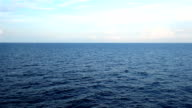 beautiful blue sky and moving beautiful deep blue sea with white cloud in sky video