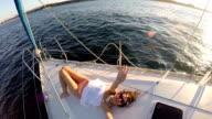 Beautiful boho woman sunbathing on an yacht video